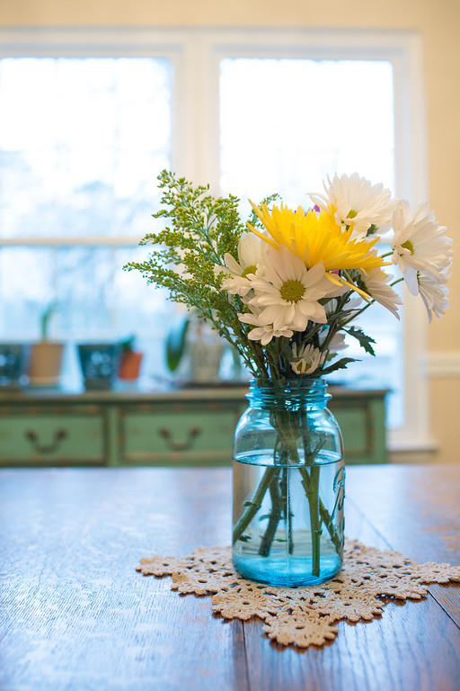 Store bought bouquet in blue mason jar.