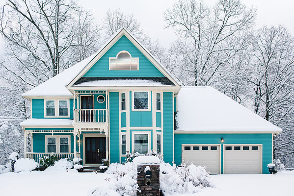 Snow on blue house.