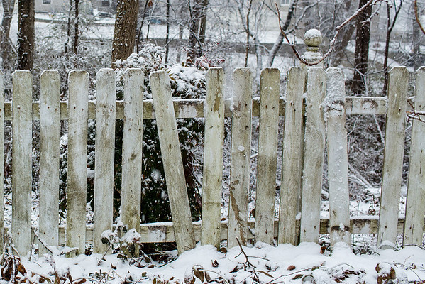 Sidewalk Shoes picket fence with snow