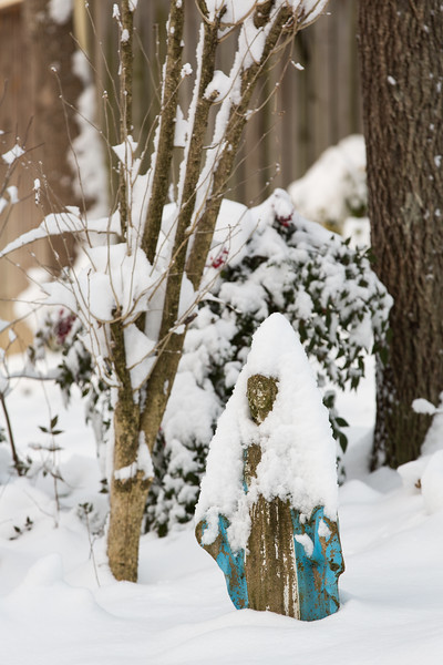 Vintage Mary yard statue with snow
