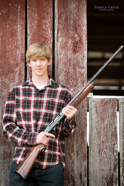 Senior boy with rifle
