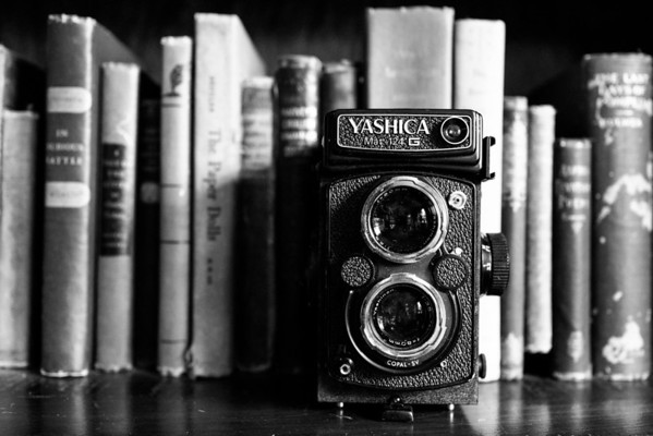 Old Yashica camera in front of old books