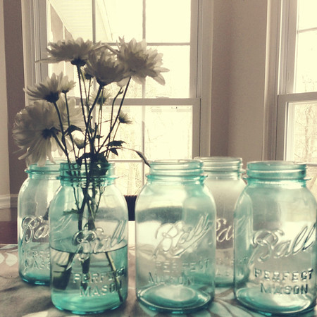 Blue ball jars with daisies
