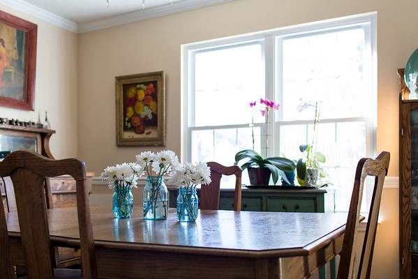 dining room with flowers in vases and orchids