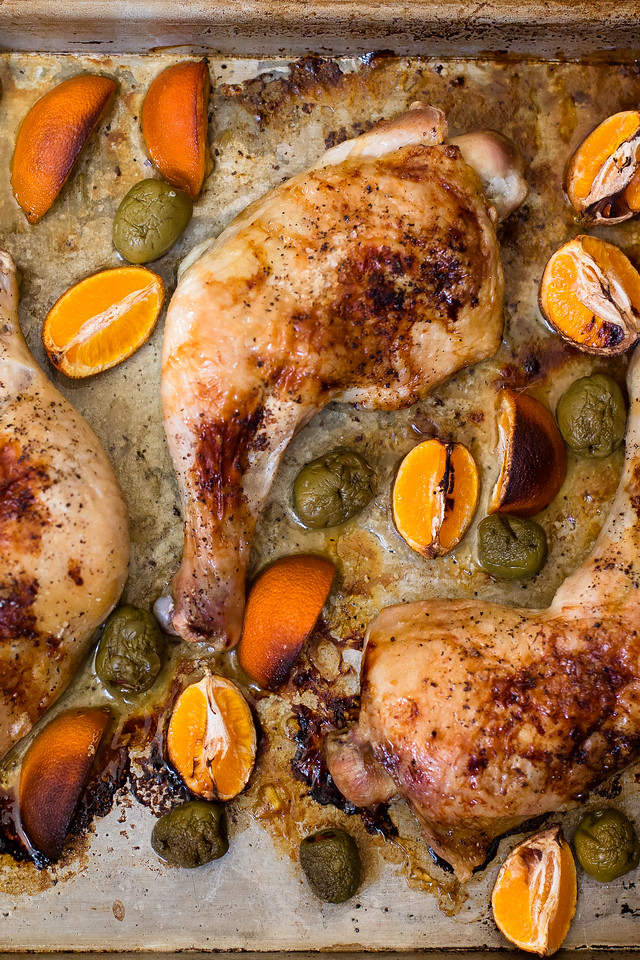 Whole chicken legs roast along side tangerines and olives in this easy chicken recipe - Roasted Chicken with Tangerines and Olives.