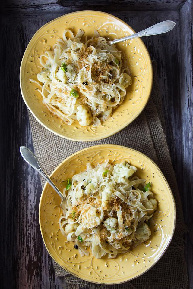 Sicilian-Style Spaghetti - cauliflower, pasta, rasins, pine nuts, and anchovies make a delicious pasta!