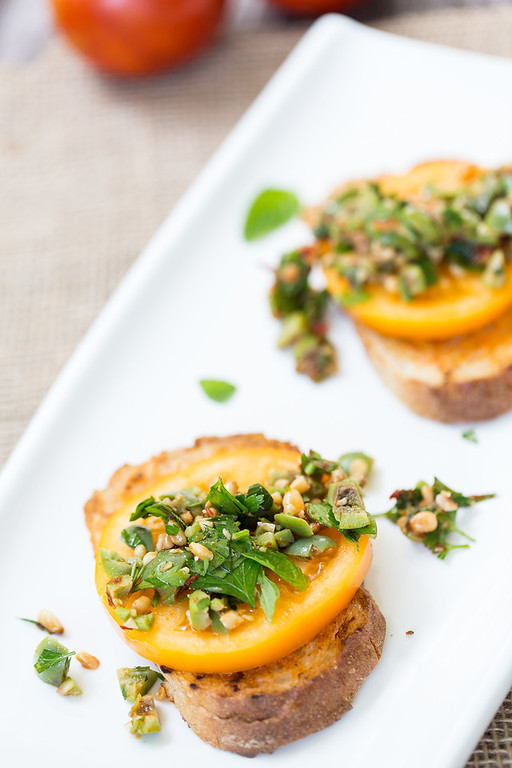 Heirloom tomato, harissa, and green olive bruschetta