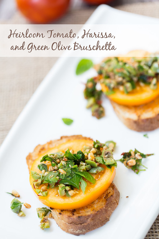 Heirloom tomato, harissa, and green olives bruschetta