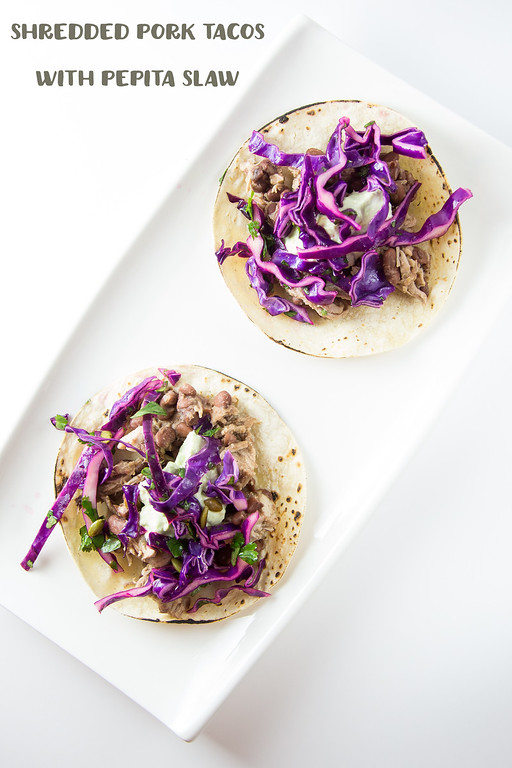 Shredded Pork Tacos with Pepita Slaw - pork, pinto beans, pumpkin seeds, and cabbage make an amazing taco!