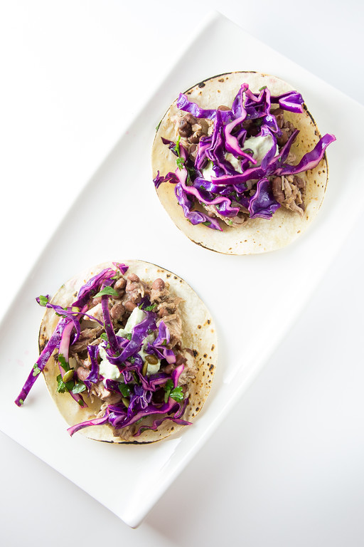 Shredded Pork and Bean Tacos with Pepita Slaw