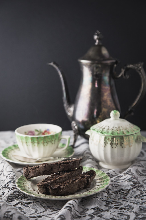 Chocolate biscotti on antique china
