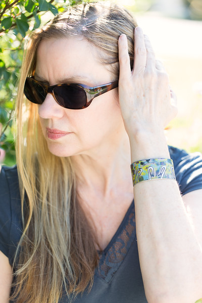Peggy Petrey Abstract Wares cuff and Ray Bans sunglasses