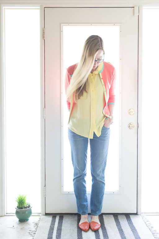 Melon colored spring sweater with butter yellow shirt for a casual spring outfit of the day. Fashion Over 50.