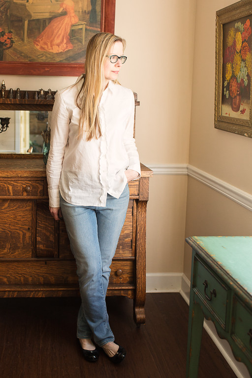White Tommy Hillfiger shirt, levi jeans, and Tahari flats
