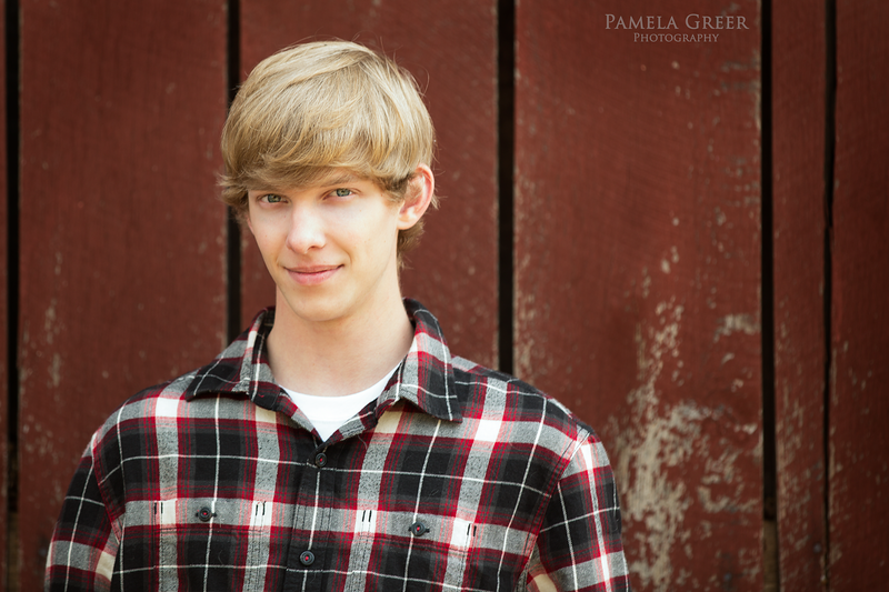 Chattanooga Senior session boy in plaid shirt in front of old barn